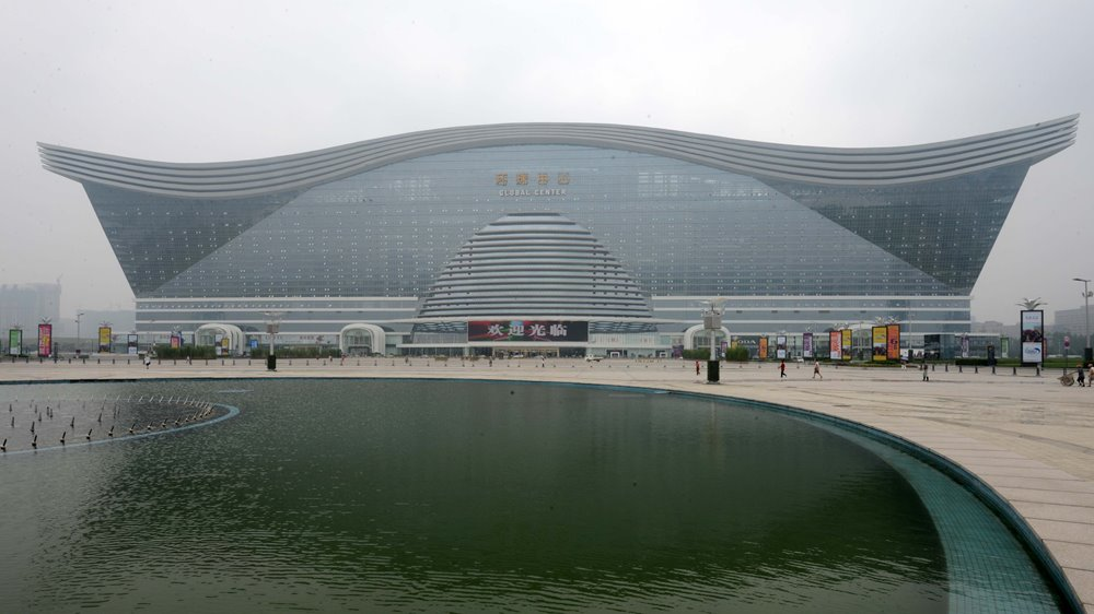http://www.dailymail.co.uk/news/article-2360182/Take-look-inside-worlds-biggest-building-Chinese-dome-houses-shopping-centre-Mediterranean-village-water-park--ice-skating-rink-multiple-hotels.html